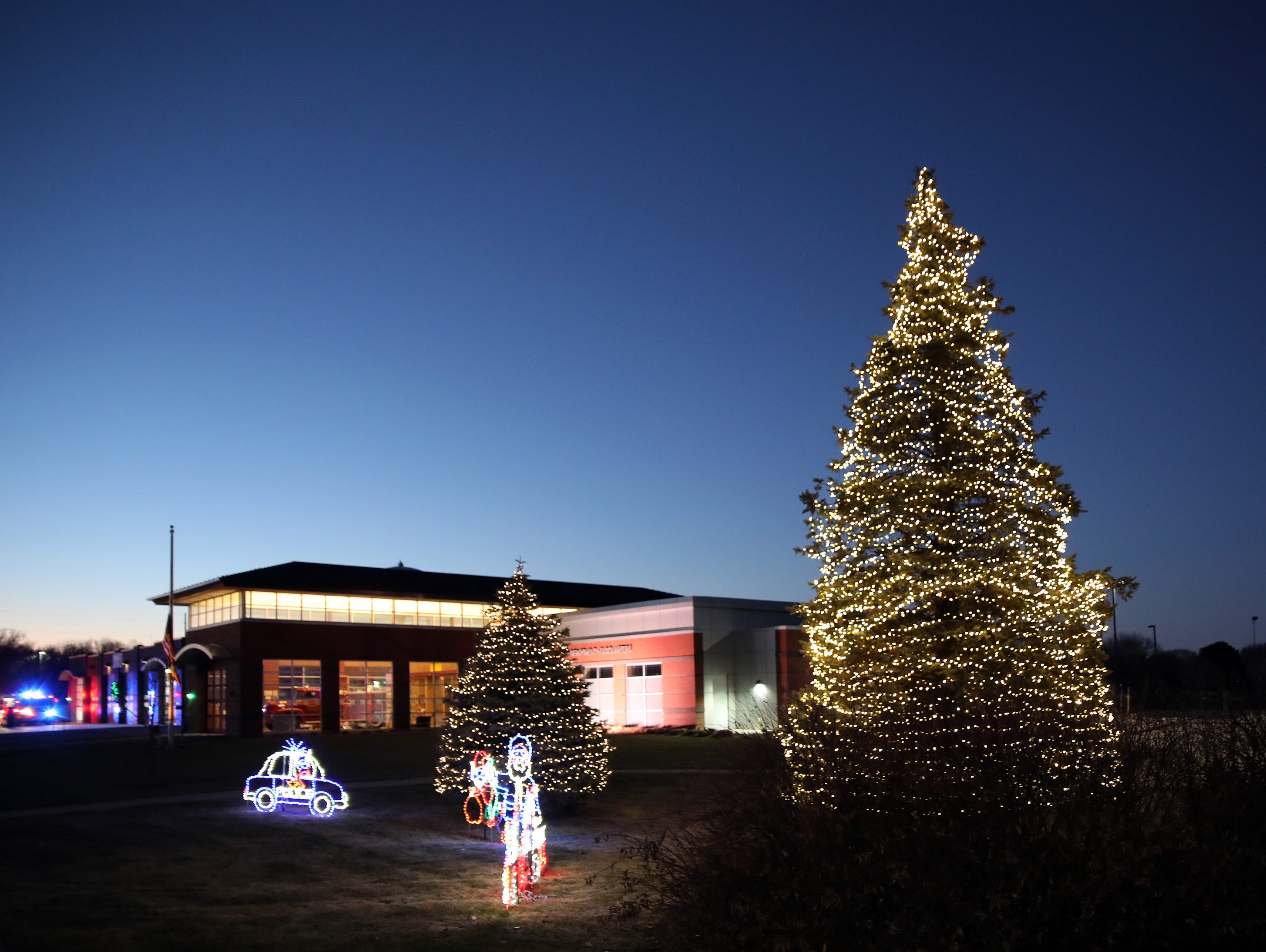 The Ankeny Fire Station is decked for the holidays as gifts are dropped off at Ankeny's fill the truck day during the U.S. Marine Corps Toys for Tots campaign at the Ankeny Fire Station Headquarters on Sunday, Dec. 16, 2018.