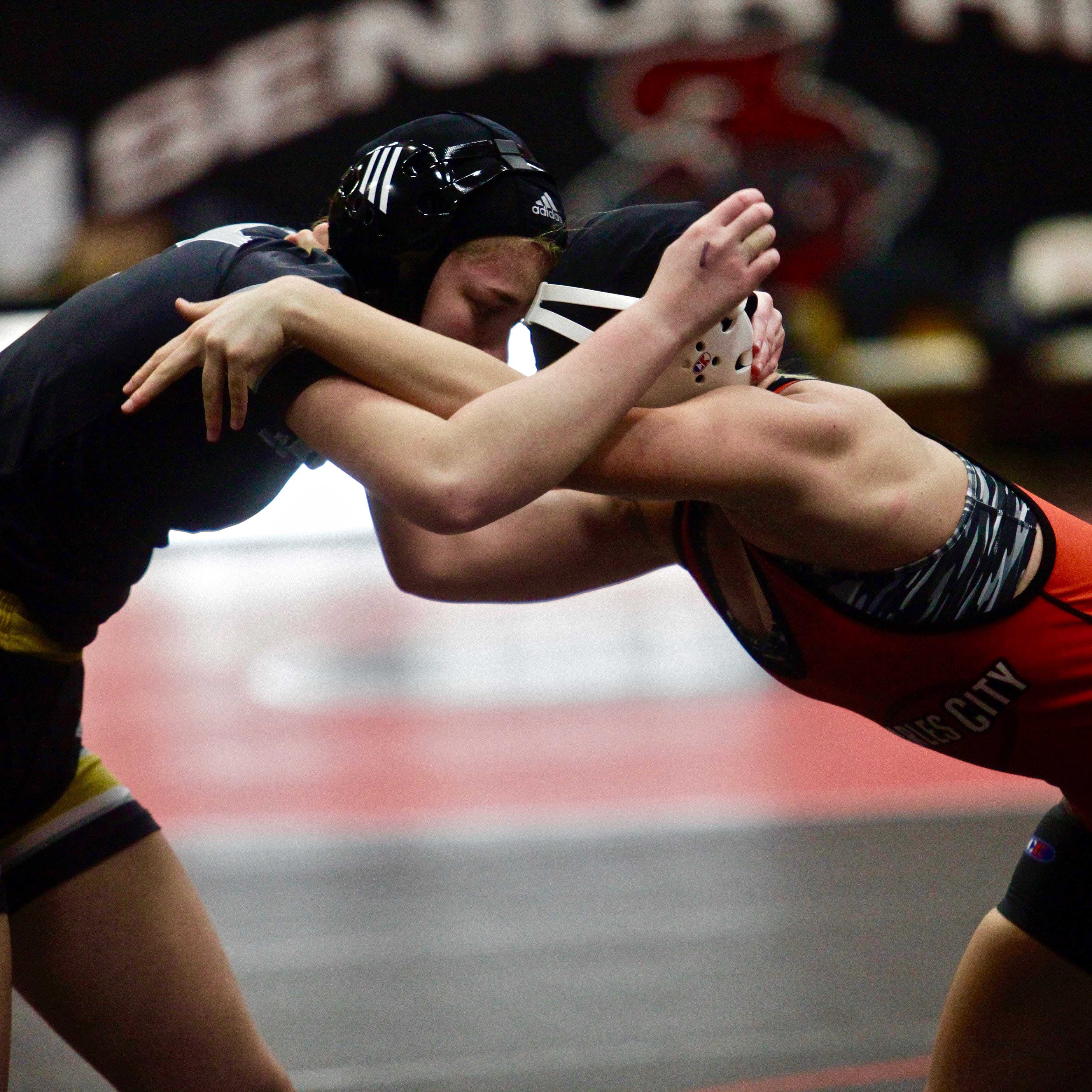 As other states add girls' wrestling, support in Iowa continues to grow