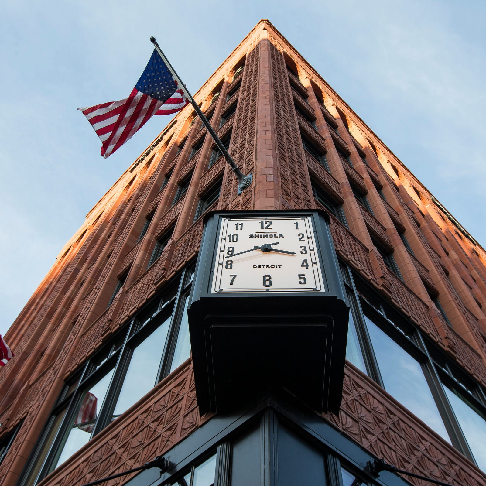 A clock installed outside of the Shinola Hotel in...