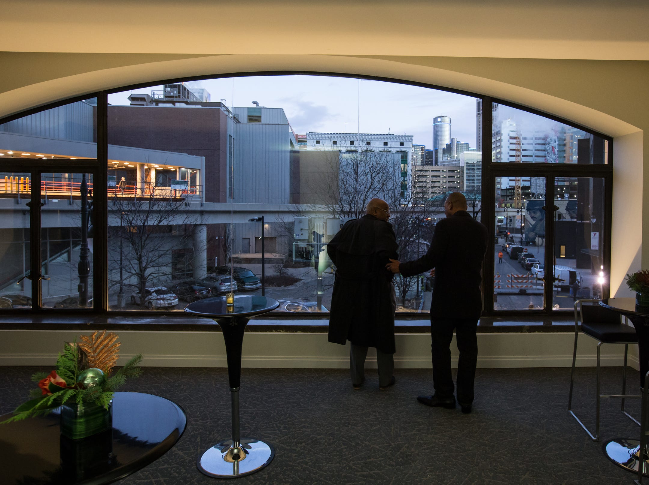 People get a view of downtown Detroit from a room in the fully restored Great Hall of the historic Metropolitan Building in downtown Detroit on Monday, December 17, 2018 after a public dedication of the building. The renovation of skyscraper will include retail, restaurants and Michigan's first Element Hotel.