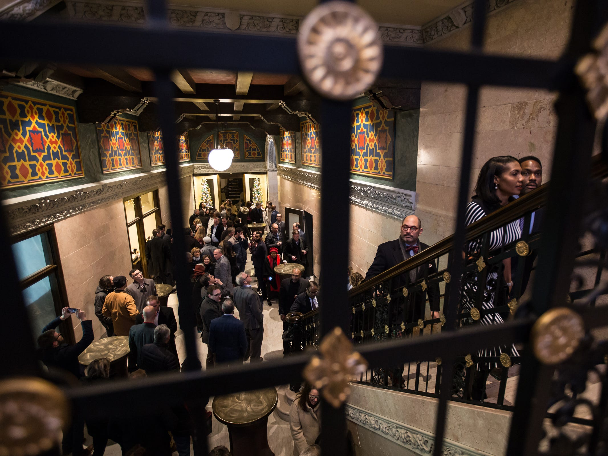 People gather to see the fully restored Great Hall of the historic Metropolitan Building in downtown Detroit on Monday, December 17, 2018. The renovation of skyscraper will include retail, restaurants and Michigan's first Element Hotel.