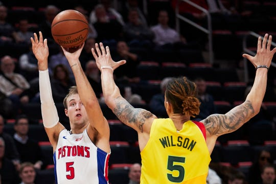 Detroit Pistons guard Luke Kennard (5) shoots on Milwaukee Bucks forward D.J. Wilson (5) in the first half at Little Caesars Arena on December 17, 2018 in Detroit.