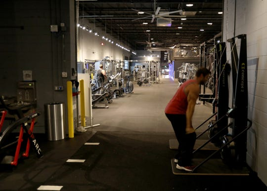 People work out Dec. 11 in the 20,000 square foot space of Pulse Fitness. It's one of ten businesses at the Iron Ridge Marketplace on the border of Ferndale and Pleasant Ridge at I-696 and Bermuda Street.