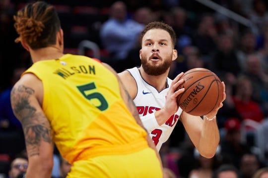 Detroit Pistons forward Blake Griffin (23) looks to shoot on Milwaukee Bucks forward D.J. Wilson (5) in the first half at Little Caesars Arena on December 17, 2018 in Detroit.