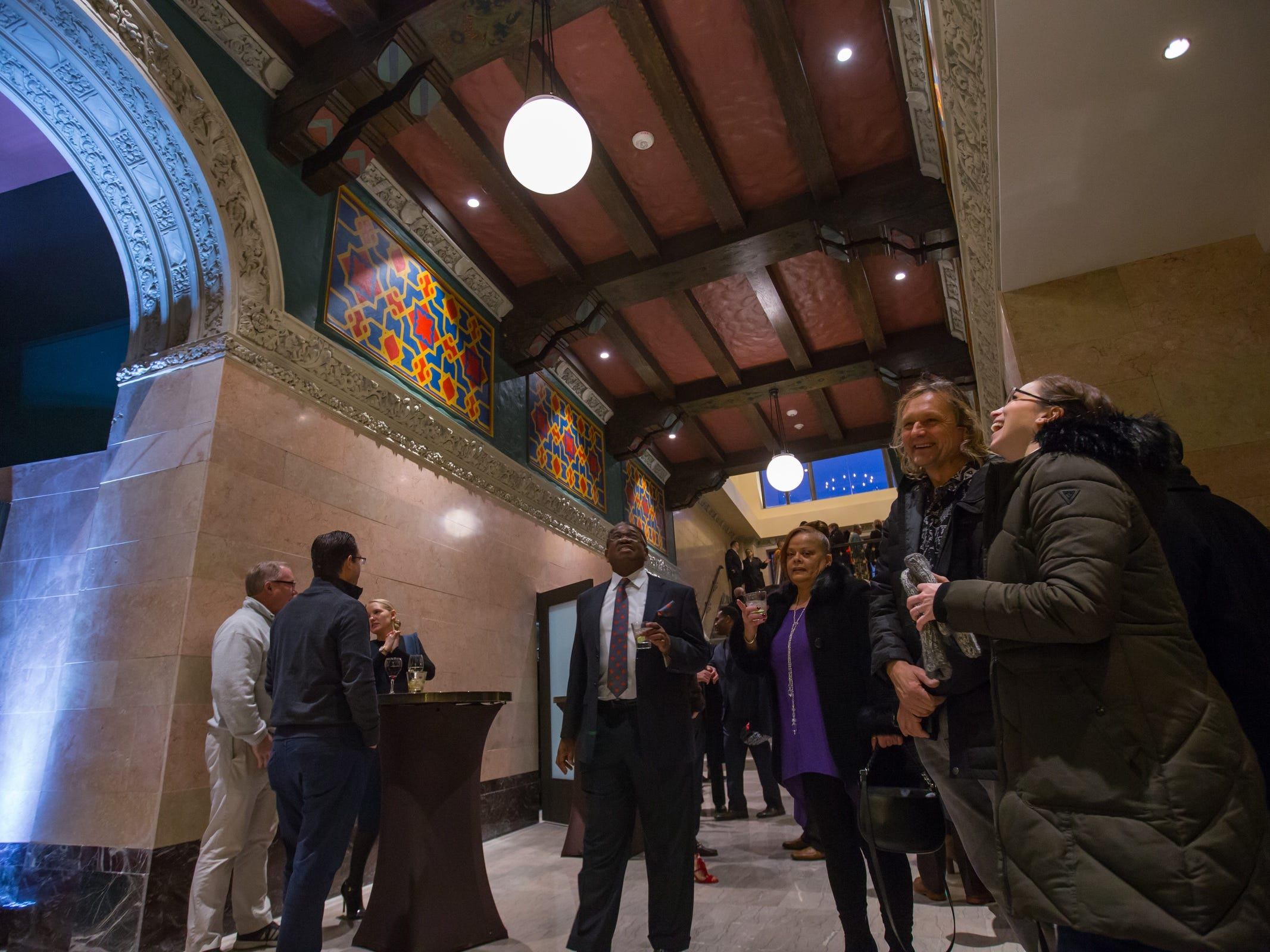 People gather to see the fully restored Great Hall of he historic Metropolitan Building in downtown Detroit on Monday, December 17, 2018.