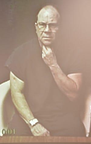 Defendant Roque E. Diegel listens via video link during his arraignment.