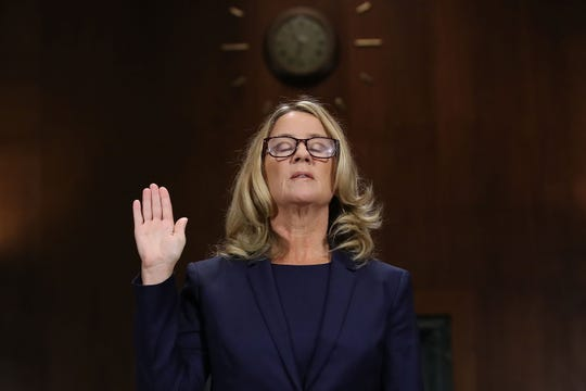 Christine Blasey Ford is sworn in before testifying to the Senate Judiciary Committee in the Dirksen Senate Office Building on Capitol Hill September 27, 2018, in Washington, D.C. A professor at Palo Alto University and a research psychologist at the Stanford University School of Medicine, Ford accused Supreme Court nominee Judge Brett Kavanaugh of sexually assaulting her during a party in 1982 when they were high school students in suburban Maryland.