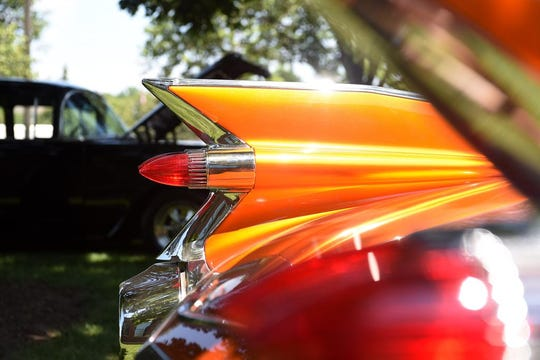 """Author William Knoedelseder called tail fins designed by Harley Earl """"wondrous creations of nature."""""""
