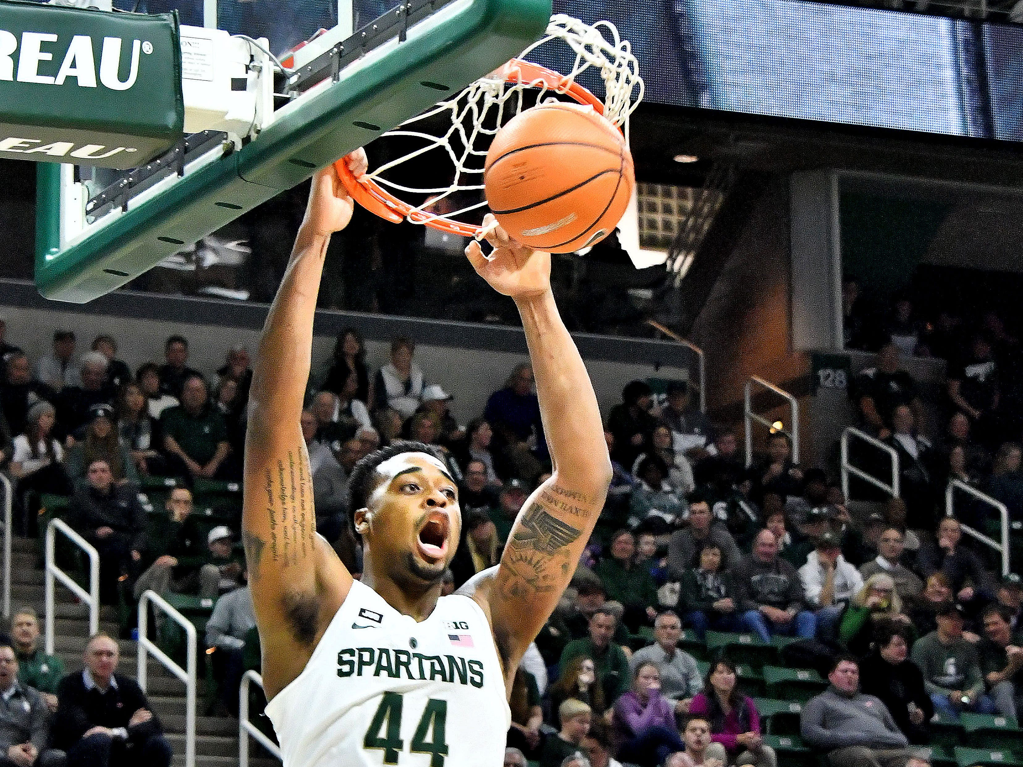Nick Ward shouts as he dunks the ball over a Rutgers player on January 10, 2018, at Breslin arena in East Lansing. Michigan State won the Big Ten regular season championship, but lost to Syracuse in the second round of the NCAA tournament.