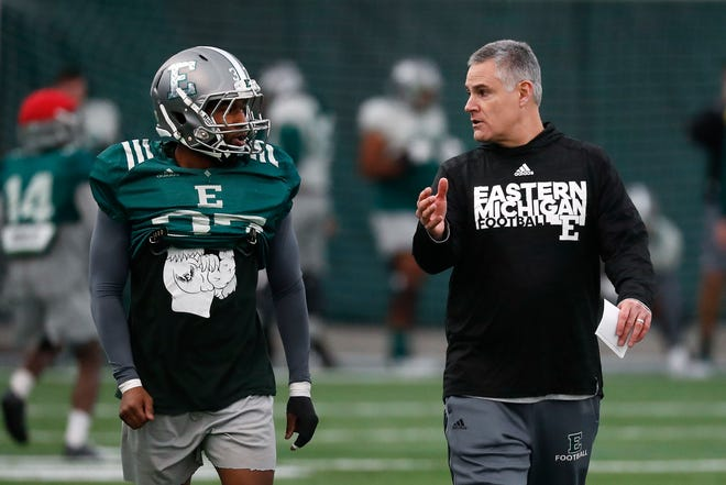 Eastern Michigan athletes, including football coach Chris Creighton and his players, will start returning Tuesday
