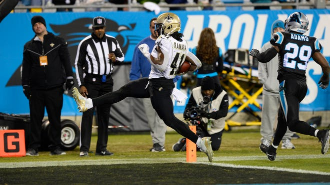 New Orleans Saints running back Alvin Kamara (41) steps into the end zone to finish a 16-yard touchdown run.