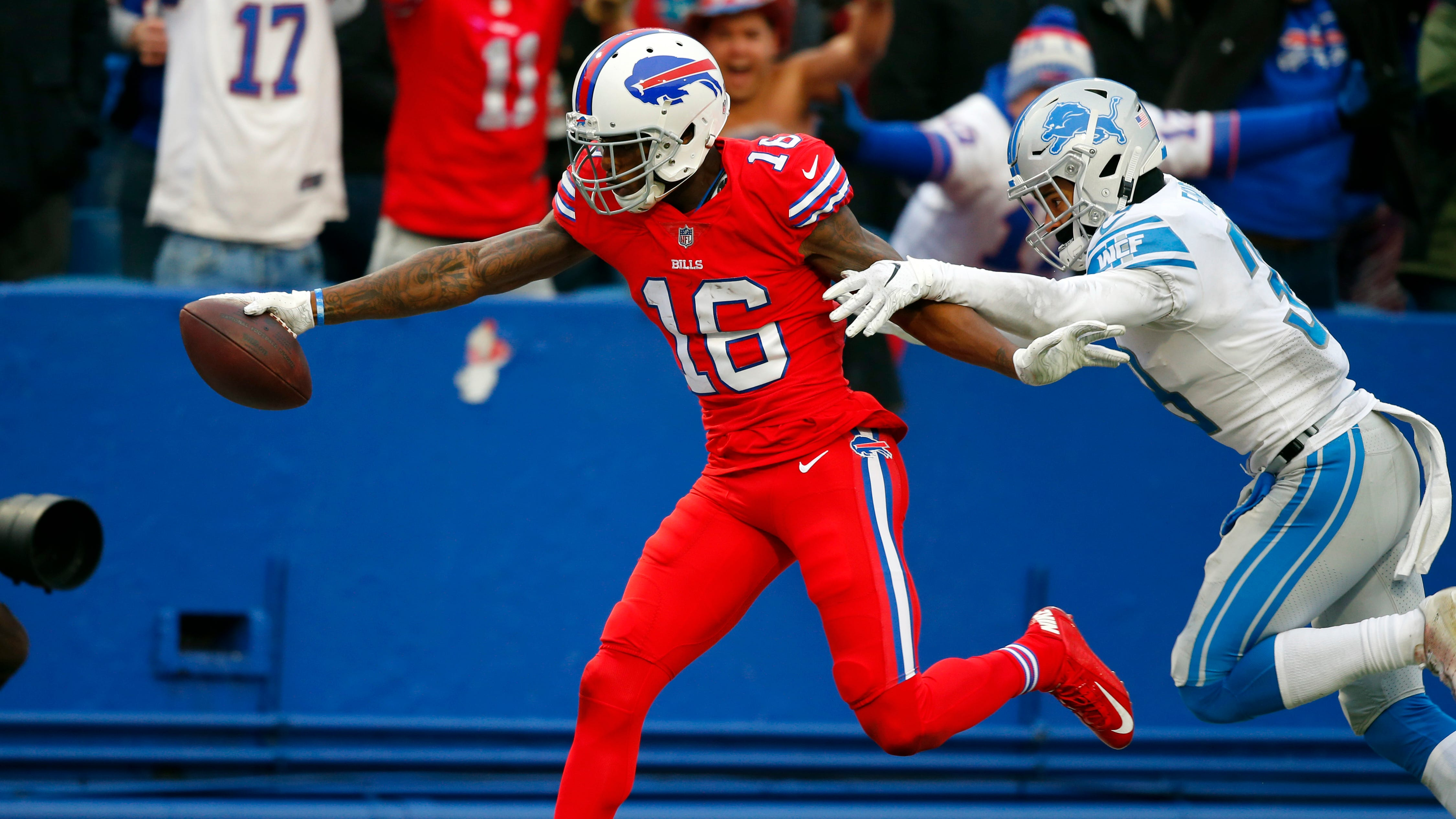 Bills rookie wide receiver Robert Foster (16) scores a 42-yard touchdown as Lions rookie defensive back Mike Ford (38) can't make the tackle Sunday in Orchard Park, N.Y.
