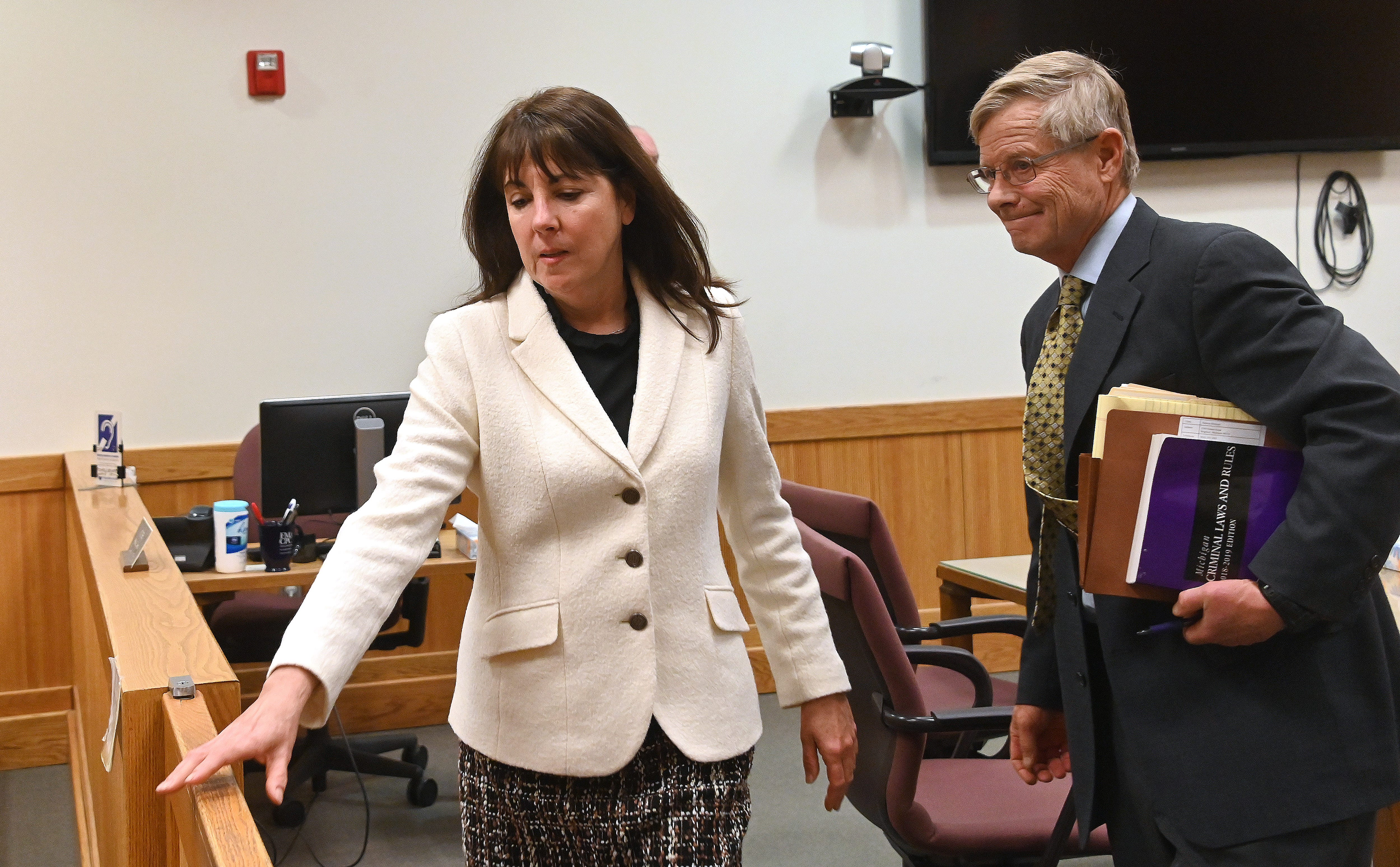 Judge Theresa Brennan leaves 53d District Court in Howell Tuesday after being arraigned on charges of perjury and tampering with evidence,  via video with Judge David Guinn in 67th District Court in Flint.