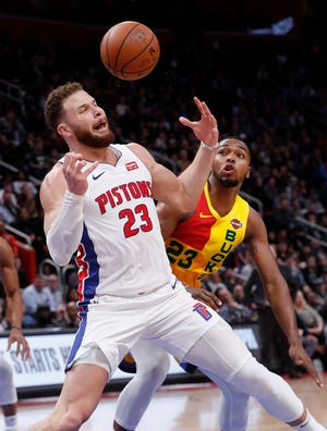 Detroit Pistons forward Blake Griffin loses the ball to Milwaukee Bucks guard Sterling Brown in the second half.