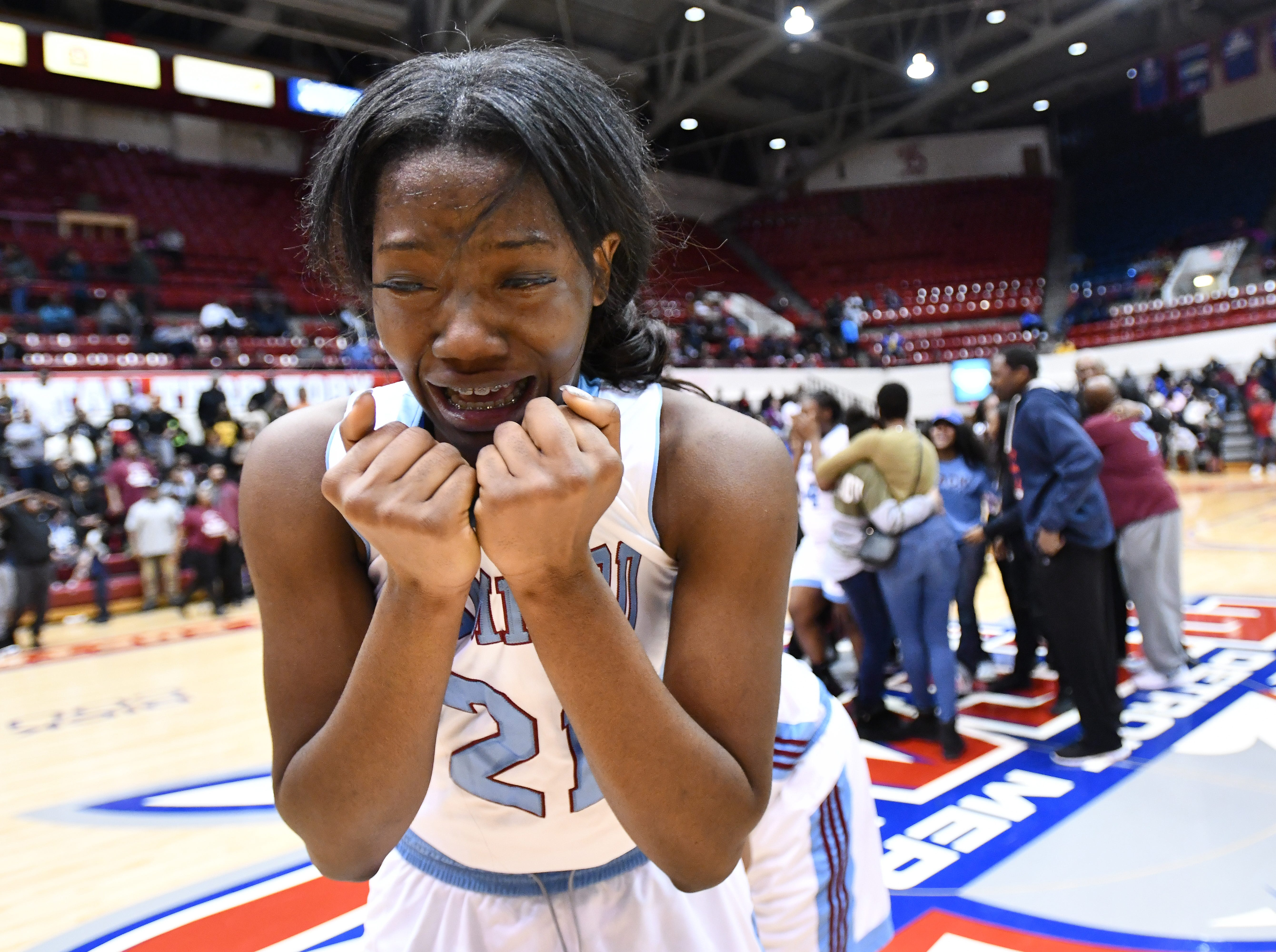 Mumford High School basketball player Zamaria Polk is overcome with emotion as the celebration begins after Mumford's 60-58 championship victory over Renaissance High School for the school's first Detroit Public School League title at Calihan Hall on the campus of the University of Detroit Mercy on February 16, 2018.