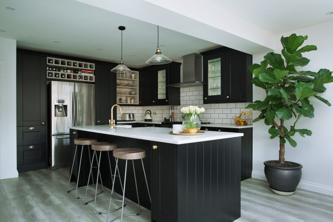 "IN: Black is here to stay in 2019, especially black and white kitchens. ""Love this with gold faucetry and gold light fixtures,"" said Troy interior designer Terry Ellis of Room Service Interior Design. ""It's basic colors with a good shelf life."""