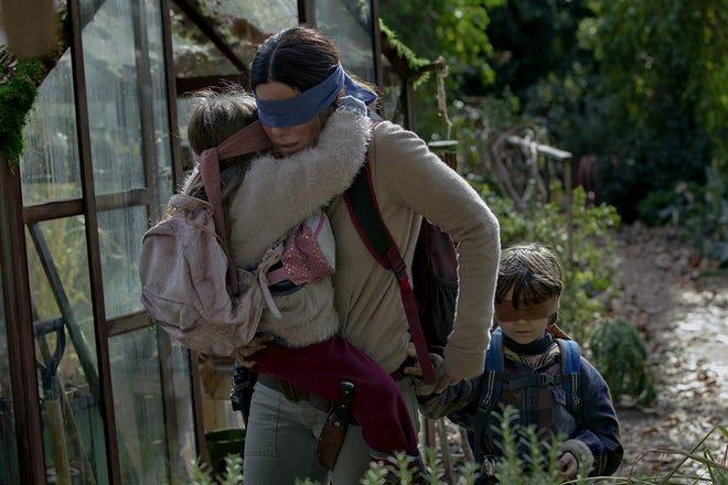 "Vivien Lyra Blair, Sandra Bullock and Julian Edwards in ""Bird Box."""
