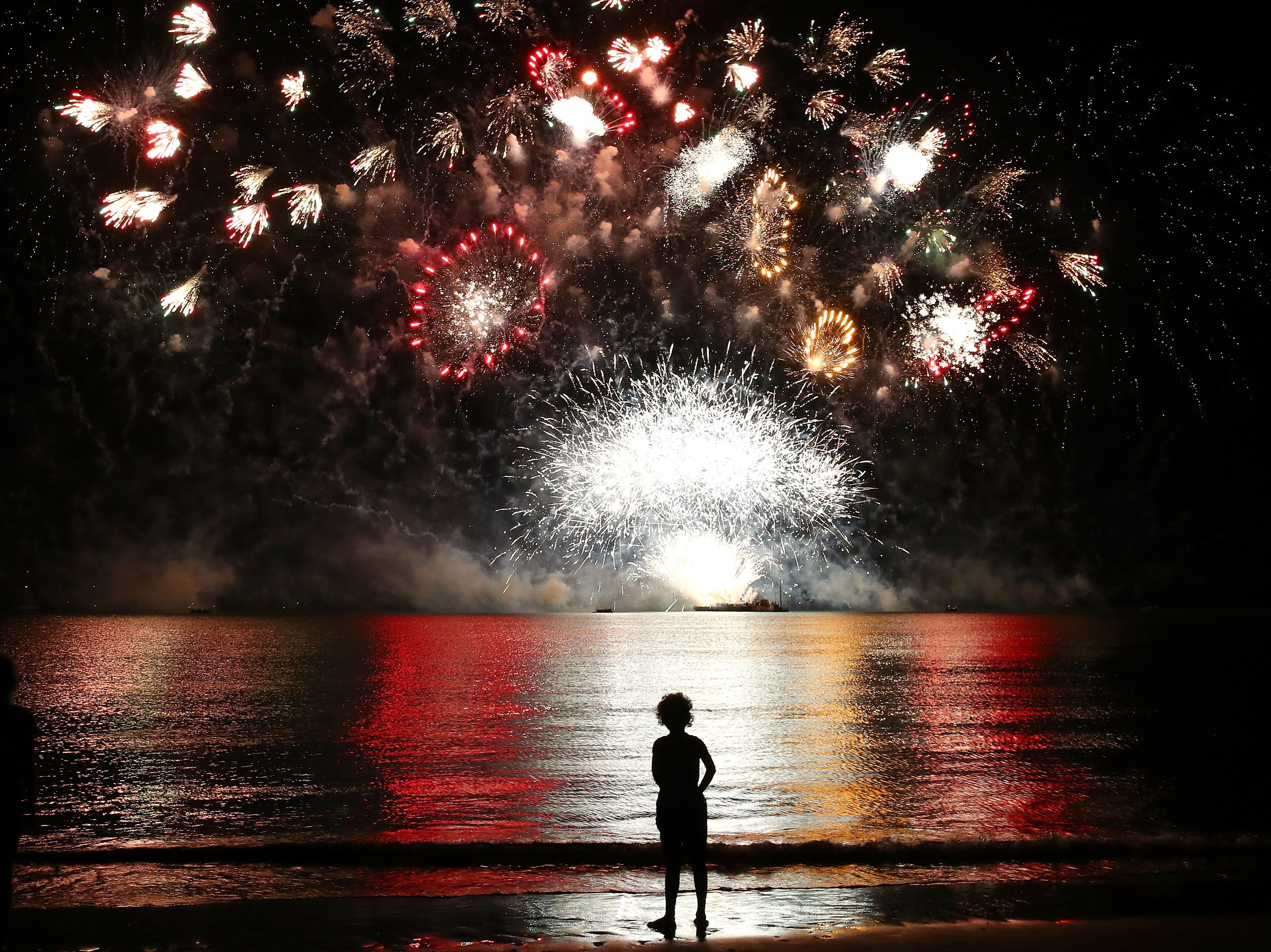 A young girl watches the  fireworks display during Territory Day celebrations at Mindil Beach on July 1, 2018, in Darwin, Australia. Every year on July 1, Northern Territorians celebrate self-governance. It is the only day  of the year pyrotechnics are allowed to be sold to the public.