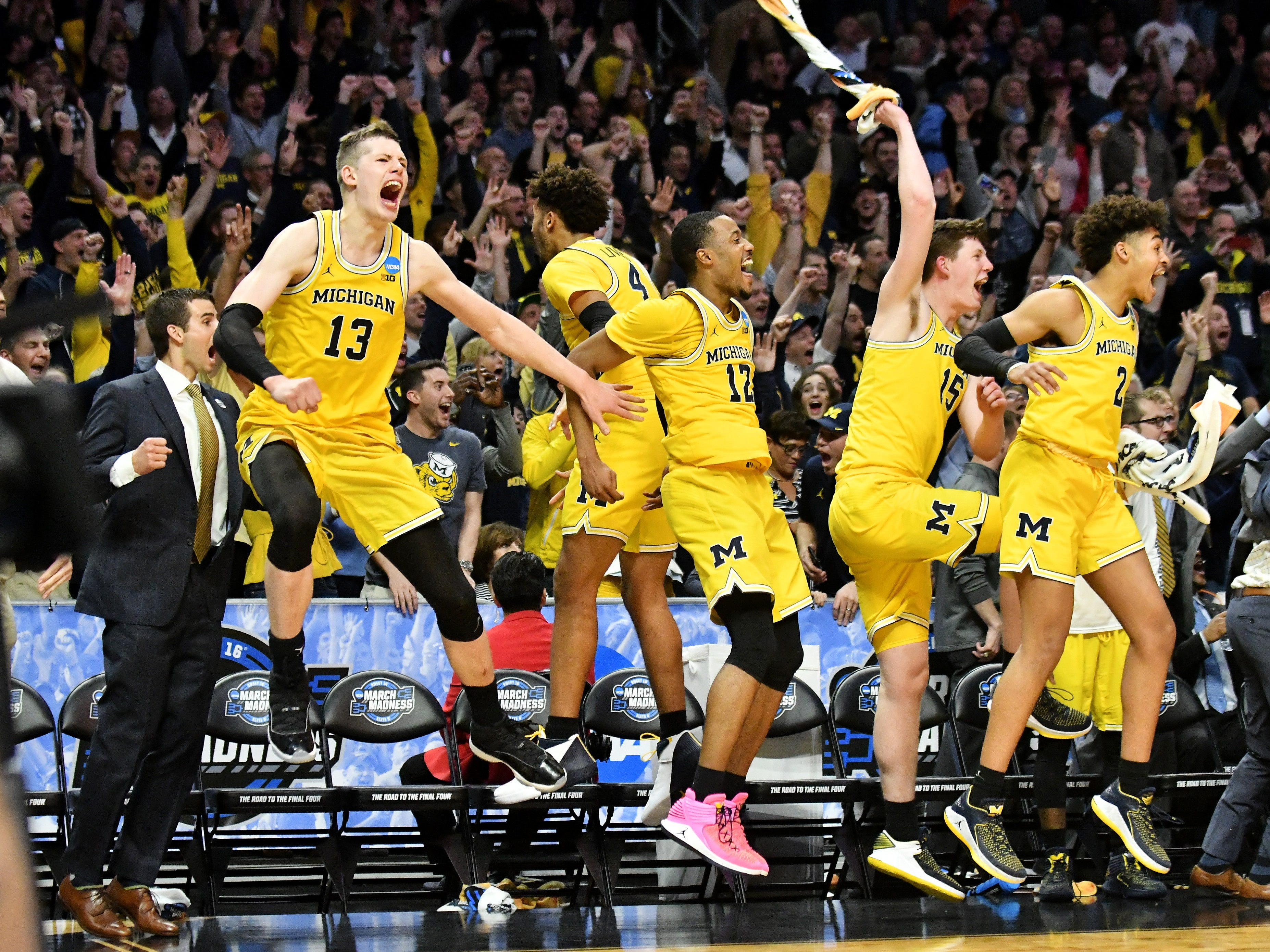 Players on the Michigan bench react after Michigan forward C.J. Baird hit a three-point shot late in a dominant 99-72 victory in the NCAA Sweet Sixteen game at the Staples Center in Los Angeles, Calif. on March 22, 2018. Michigan improbable tournament run ended in a lopsided loss to Villanova in the NCAA championship game.