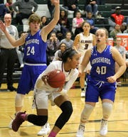 Zaria DeMember-Shazer looks for room in the paint as Jillian Casey (24) and Tess Cites (40) of Horseheads defend Dec. 17, 2018 at Elmira High School.
