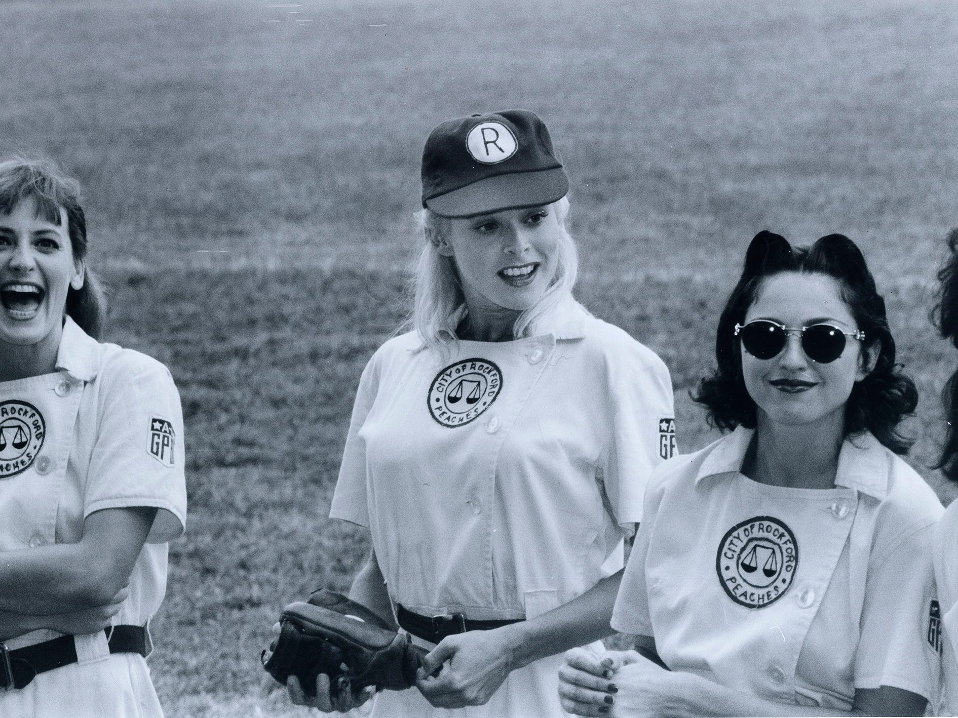 "Lori Petty, left, Freddie Simpson, middle, and Madonna on the set of ""A League of Their Own"" at Bosse Field in Evansville, Indiana."