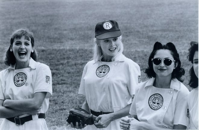 """Freddie Simpson (center) with Madonna (right) and Lori Petty on the set of """"A League of Their Own"""" at Bosse Field in Evansville, Indiana."""