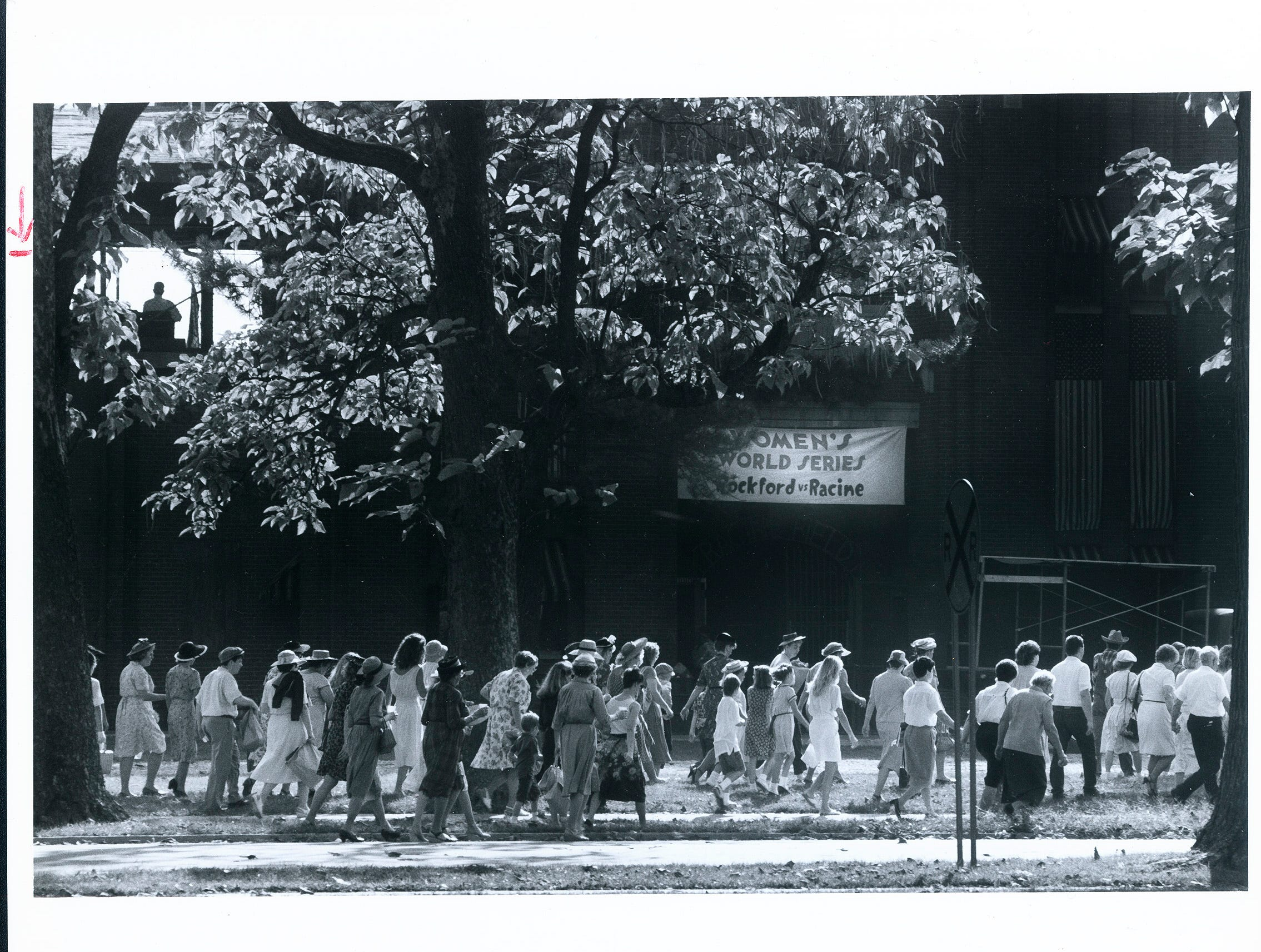 "People from all over waited inlines, that snaked through Garvin Park, up to four hours just to be a part of the movie ""A League of Their Own."""