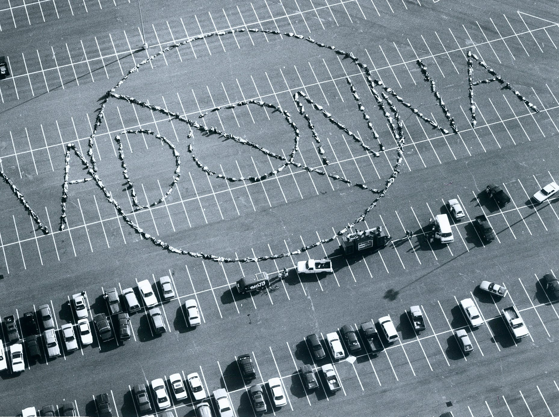Approximately 300 residents of Evansville and the Tri-State showed up Saturday afternoon to spell out a message to Madonna on the parking lot of Roberts Stadium. The human message was prompted by the non flattering remarks that Madonna made about the city of Evansville in a recent TV Guide interview.