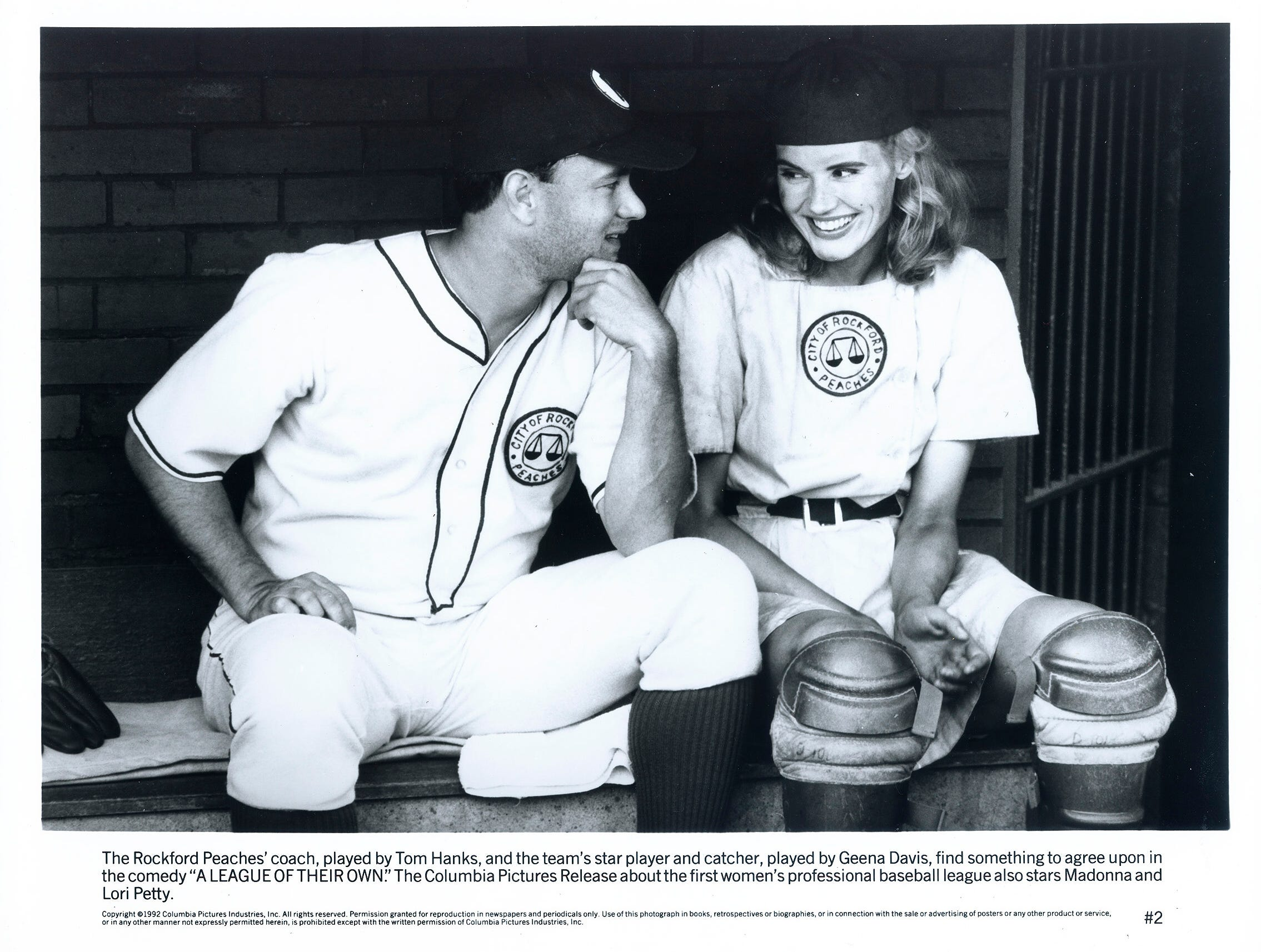 "The Rockford Peaches' coach, played by tom Hanks and the team's star player and catcher, played by Geena Davis, find something to agree upon in the comedy ""A League of Their Own."""