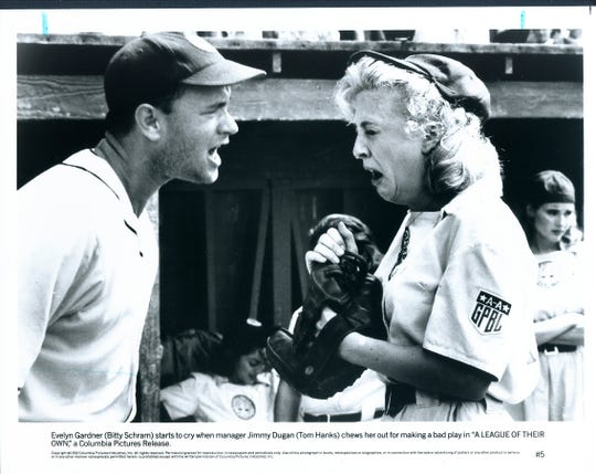 "A still from the movie ""A League of Their Own"" when Evelyn Gardner (Bitty Schram) starts to cry when manager Jimmy Dugan (Tom Hanks) chews her out for making a bad play."