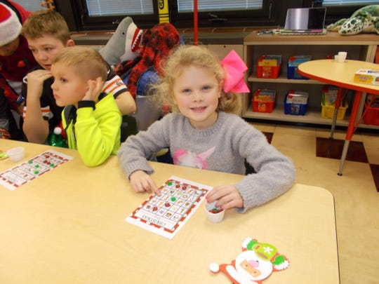 Darcy Jones plays Christmas Bingo in Brandon Mussell's class during the Holiday Extravaganza.