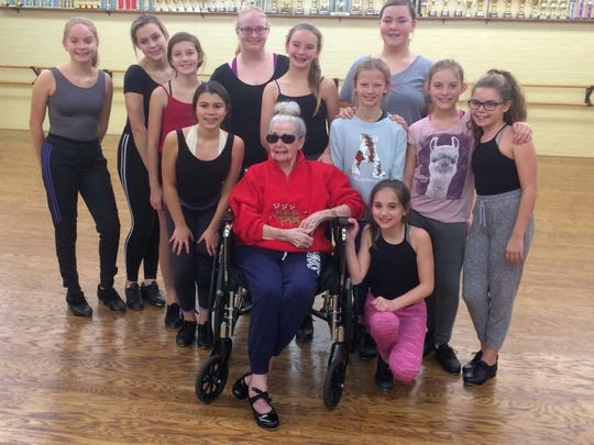 Maggie Callendar, center, visits a tap dancing class at Class Act Dance Studio in Clyde with girls from the Junior Competition Dancers.