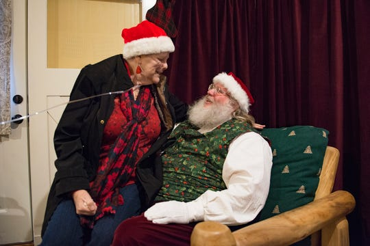 Glenda Seitz asks Santa Claus for more strength and a cure for cancer as she sits on his lap in Old Town Square on Wednesday, December 12, 2018. Glenda, in hospice care after four years of cancer, had never sat on Santa's lap.
