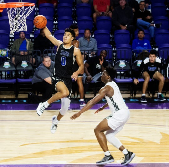 IMG's Josh Green scores against Gray Collegiate in the City of Palms Classic first round game at Suncoast Credit Union Arena on Tuesday.  Green led all scorers with 22 points.  IMG won 82-68.