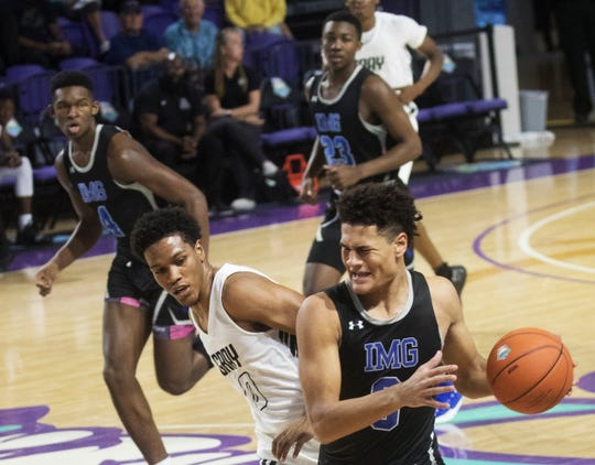 IMG Academy beat Gray Collegiate in the City of Palms Classic 82-68 first round at Suncoast Credit Union Arena on Tuesday.  IMG's Josh Green, right, led all scorers with 22 points.