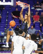 IMG Academy's Jeremiah Earl-Robinson dunks over Gray Collegiate on Tuesday. IMG Academy beat Gray Collegiate in the City of Palms Classic 82-68 first round at Suncoast Credit Union Arena.  IMG's Josh Green led all scorers with 22 points.