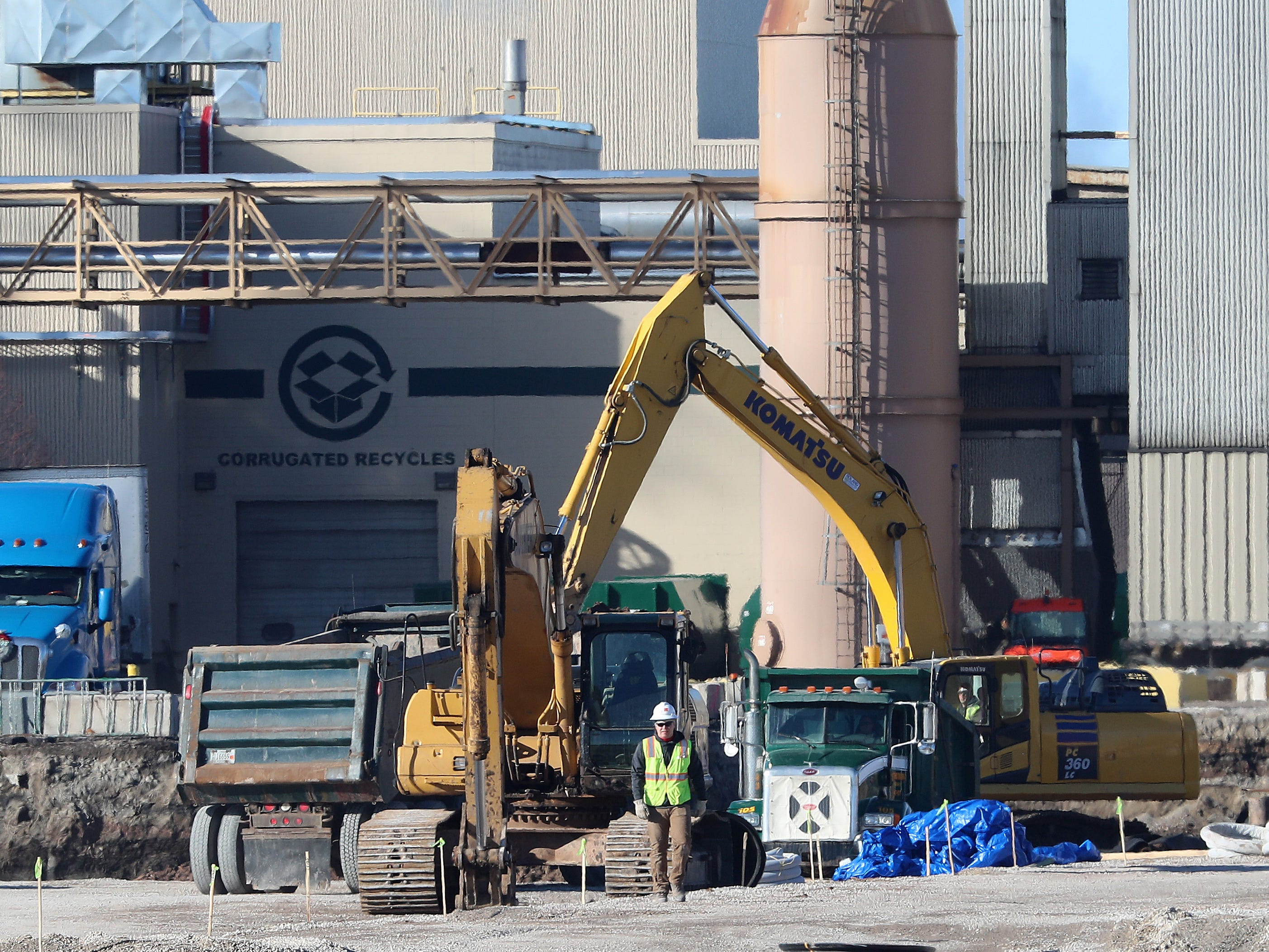 Utility work is underway at the construction site of the Green Bay Packaging mill off Quincy Street in Green Bay. The $580 million plant expansion is expected to retain 600 jobs and add another 200 jobs in the future.