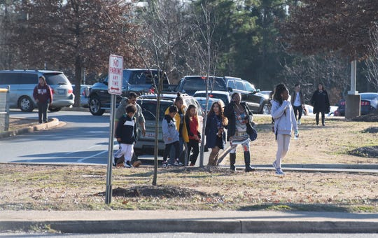 People leave Carolina High School Tuesday, Dec. 18, 2018 after students were released from the school following a threat.