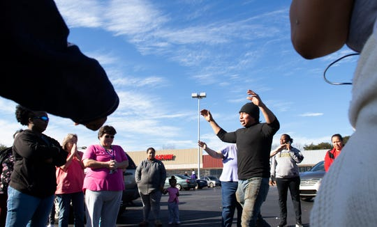 Martin Pedro leads a prayer in the parking lot across from Carolina High School after a threat was called into the school Tuesday, Dec. 18, 2018.