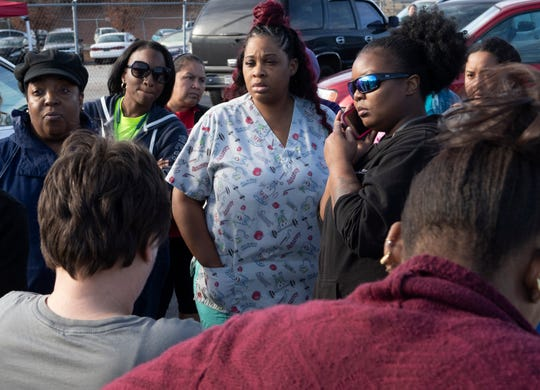 Parents talk with Greenville County school district officials after a threat to Carolina High School Tuesday, Dec. 18, 2018.