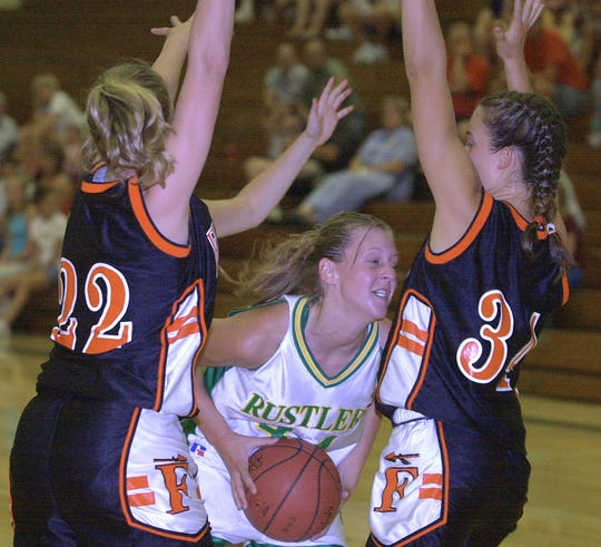 C.M. Russell High's Erin Goodman works to score against the Kalispell Flathead defense in 2001.