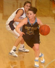 Point guard Kassie Holmlund starred for the CMR Rustlers and played college basketball for the University of Great Falls (now Providence) Lady Argos.