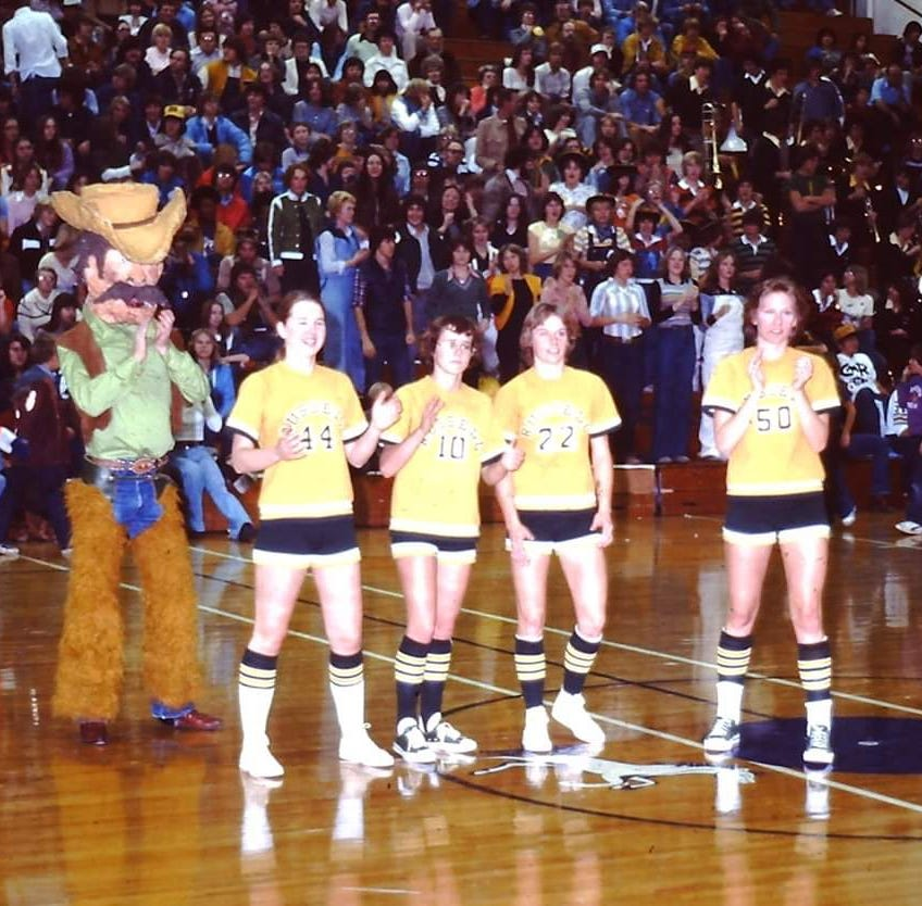 Pictured with the CMR mascot before a game 40 years ago are Russell starters, from left, Kathy Fosse, Karen Jackson, Sarah Habel and Jeanne Kenzka.