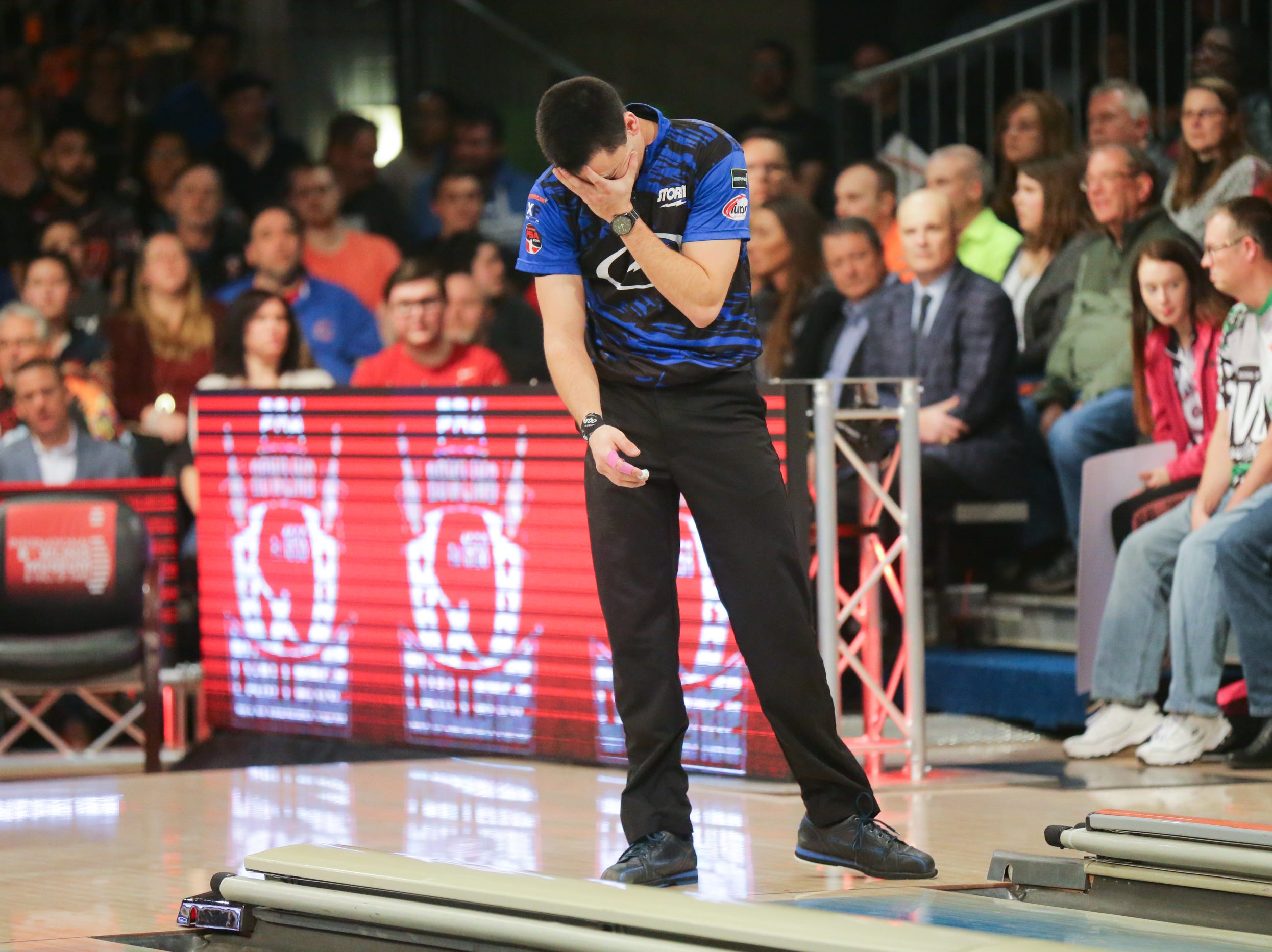 Marshall Kent reacts to his throw while bowling against Jakob Butturff during the PBA 60th Anniversary Classic held at Woodland Bowl in Indianapolis on Sunday, Feb. 18, 2018. Jakob Butturff won the stepladder finals.