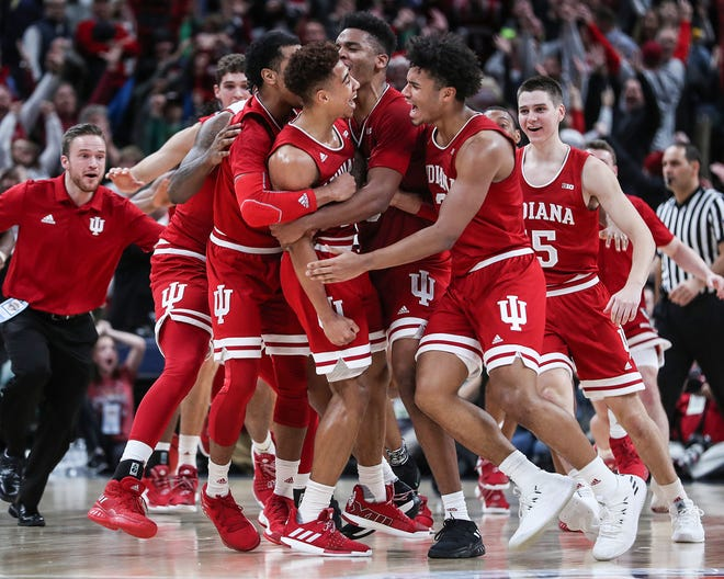 Another last-second victory for the Indiana Hoosiers. The team celebrated after Rob Phinisee hit a three-point shot at the buzzer to defeat Butler on Saturday in the Crossroads Classic at Banker's Life Fieldhouse. The Hoosiers won, 71-68.