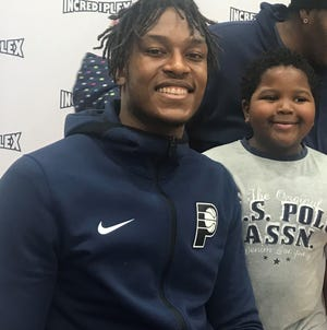 Pacers player Myles Turner hung out with kids at Incrediplex Monday, including James Bumphus. James said he likes  when Turner shoots 3-pointers.