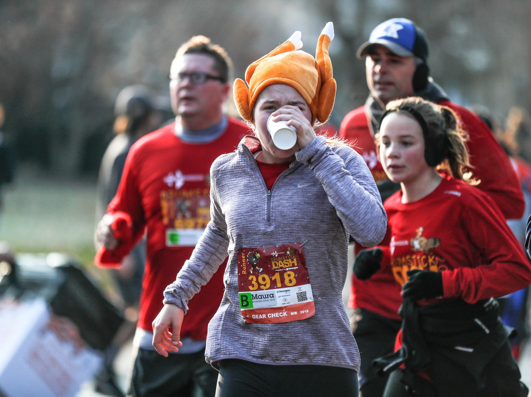 A runner wears a turkey had while running in the 2018 Drumstick Dash, held on Thanksgiving morning, in Broad Ripple Village in Indianapolis on Thursday, Nov. 22nd, 2018. Proceeds benefit Wheeler Mission.