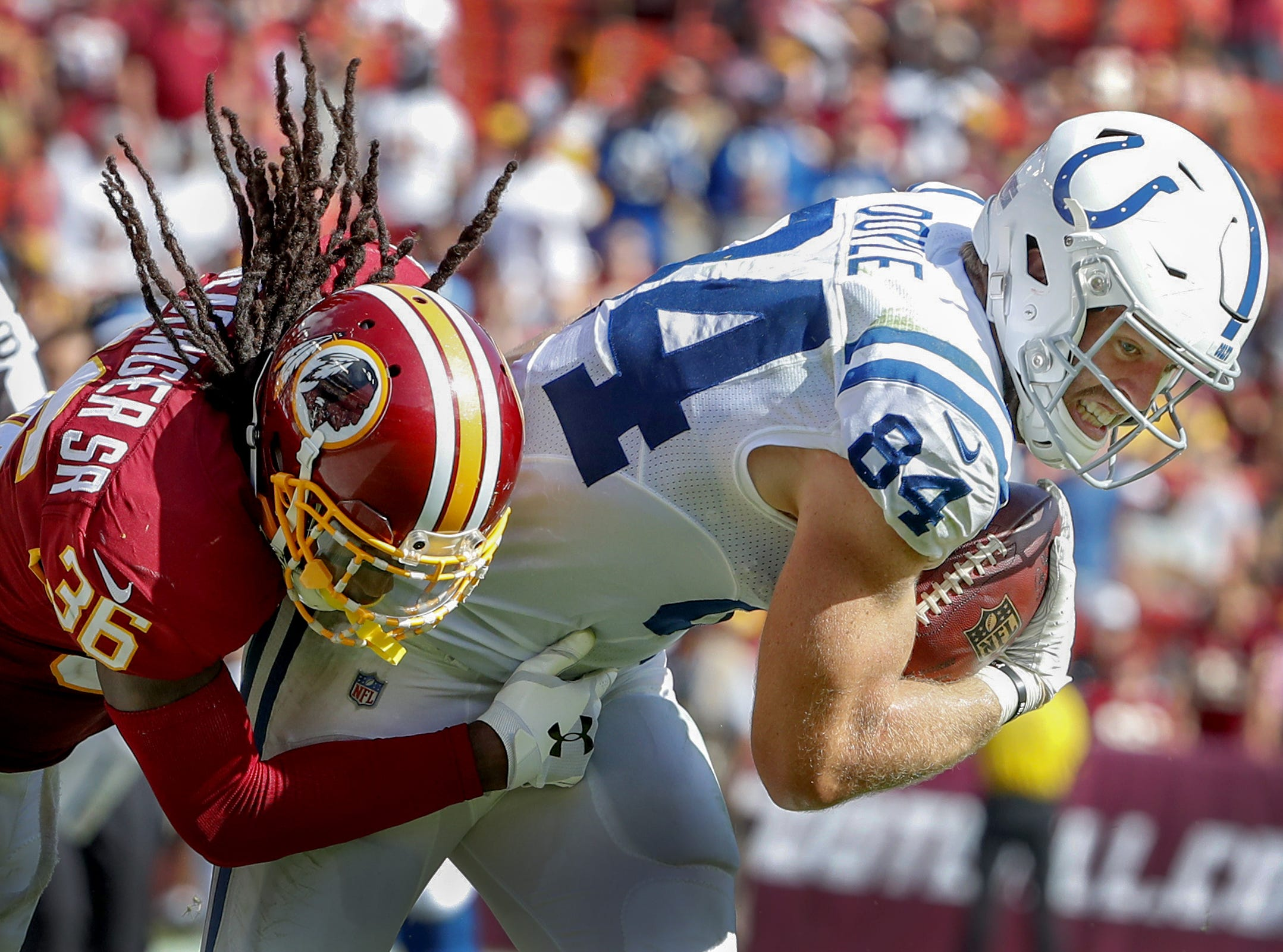 Indianapolis Colts tight end Jack Doyle (84) is pulled down by Washington Redskins defensive back D.J. Swearinger (36) in the second half of their game at FedEx Field in Landover MD. on Sunday, Sept. 16, 2018.