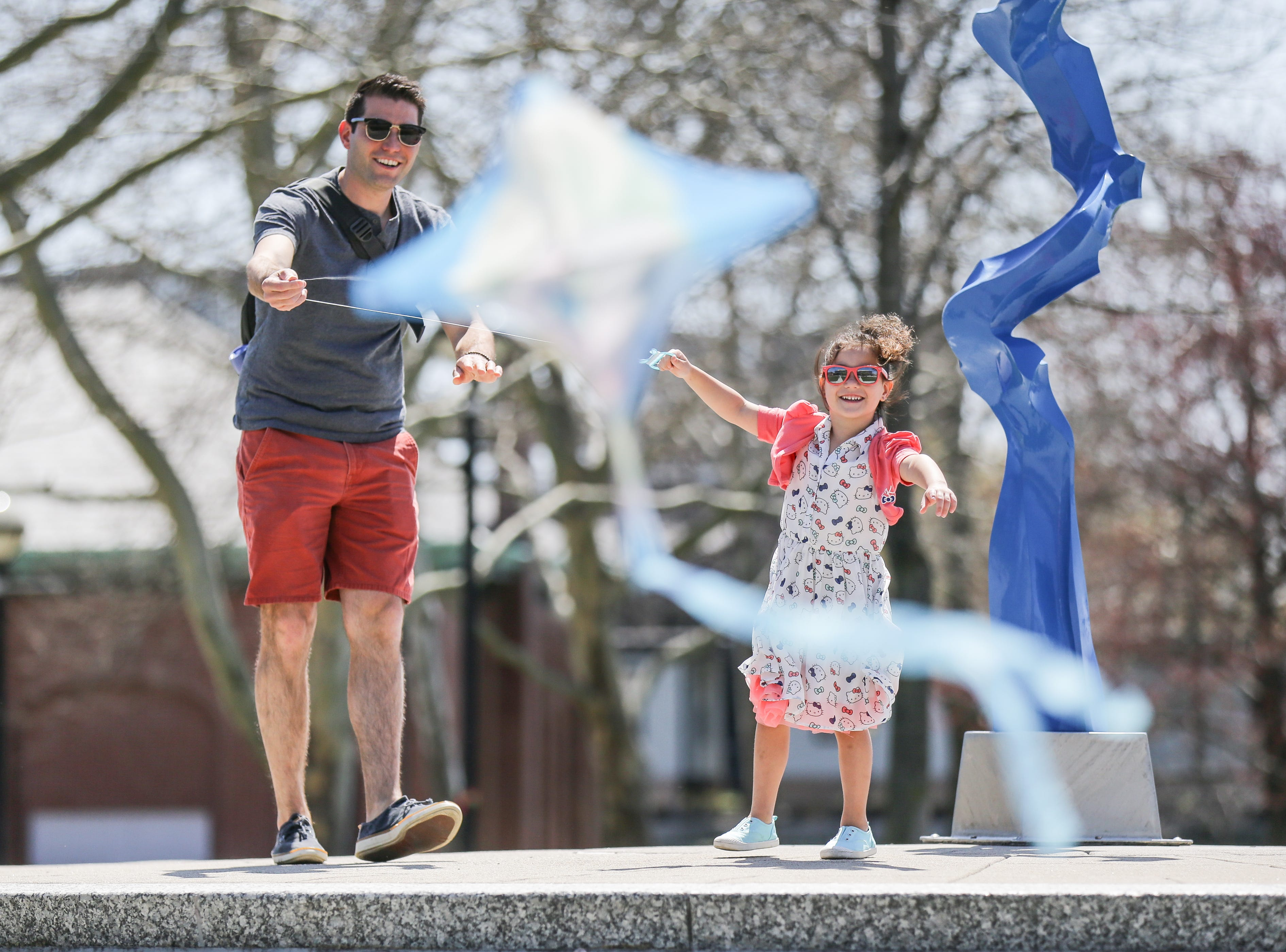Randy Roberson and his daughter Brianna Roberson fly a kite at the White River State Park in Indianapolis on Thursday, April 12, 2018.