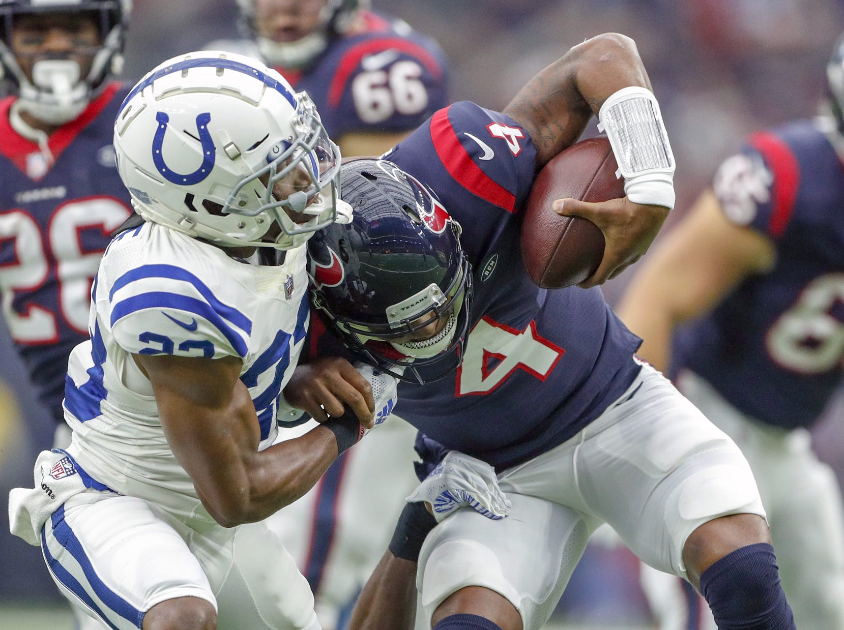 Indianapolis Colts cornerback Kenny Moore (23) sacks Houston Texans quarterback Deshaun Watson (4) at NRG Stadium in Houston on Sunday, Dec. 9, 2018.